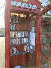 Telephone box with books